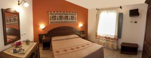 A bed or beds in a room at Hotel Bia Maore