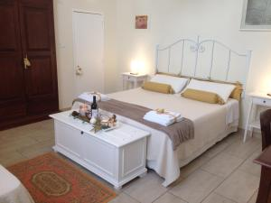 Gino's House B&B tesisinde bir odada yatak veya yataklar