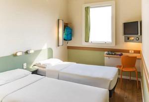 Cama ou camas em um quarto em ibis budget Rio de Janeiro Centro