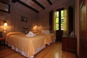 Una cama o camas en una habitación de Casa Glebinias