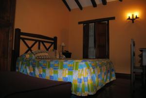 A bed or beds in a room at Posada El Pescador