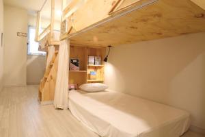 올레 스테이 객실 침대