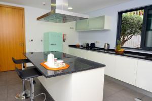 A kitchen or kitchenette at Casas do Forte do Pico