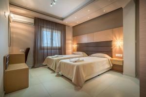 Een bed of bedden in een kamer bij Kymothoe Elite