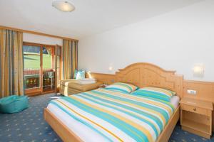 Ein Bett oder Betten in einem Zimmer der Unterkunft Hotel Lindnerhof
