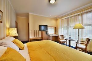 Postel nebo postele na pokoji v ubytování Hotel Villa Conti