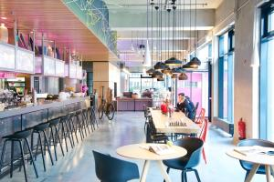 A restaurant or other place to eat at Moxy Munich Messe