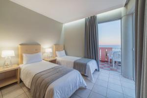Letto o letti in una camera di Xenos Kamara Beach