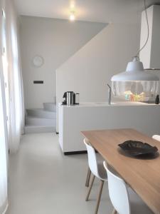 A kitchen or kitchenette at Urban Residences Maastricht