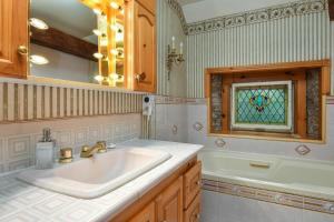A bathroom at The Noble Suites