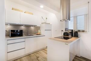 A kitchen or kitchenette at Apartment Allure