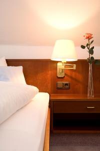 Кровать или кровати в номере Ringhotel Residenz Wittmund