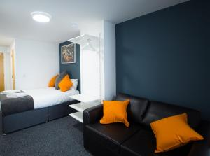 A bed or beds in a room at Fox Street Studios