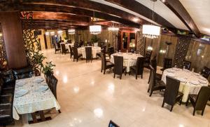 Un restaurant sau alt loc unde se poate mânca la Hotel Aramia