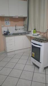 A kitchen or kitchenette at Home Sweet Home Flats