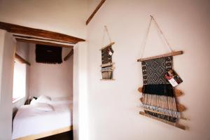 A bed or beds in a room at El Balcón