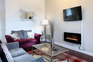 A television and/or entertainment center at Tufton Arms Hotel