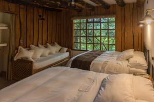 Cama o camas de una habitación en Hotel El Barranco