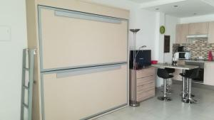 A kitchen or kitchenette at COLINA BLANCA TENERIFE.