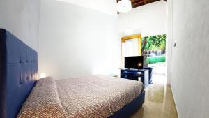 Ein Bett oder Betten in einem Zimmer der Unterkunft Beverello Suite