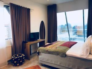 Кровать или кровати в номере Бутик Отель 12