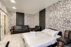 Кровать или кровати в номере Apartment Tverskaya-Yamskaya 26
