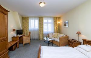 Ein Sitzbereich in der Unterkunft Hotel Union