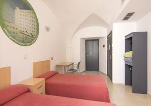 Letto o letti in una camera di Albergue Inturjoven Córdoba