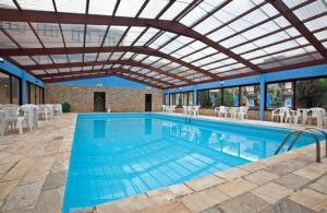 A piscina localizada em Hotel Fazenda Figueiras ou nos arredores