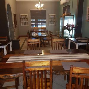 A restaurant or other place to eat at Stoep Cafe Guest House