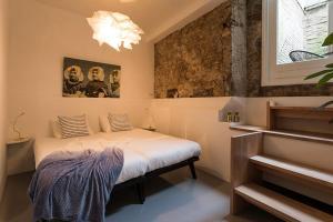 Een bed of bedden in een kamer bij HOTELdeBEAUTEL