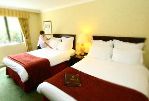 A bed or beds in a room at Urban Hotel Grantham