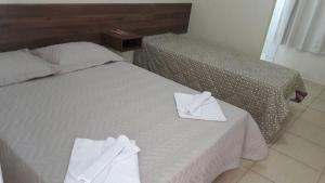 A bed or beds in a room at Hotel Potencial