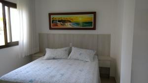 Cama ou camas em um quarto em Apartamento Residencial Mediterrâneo Iberostate Praia do Forte