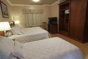 Cama ou camas em um quarto em Pousada Bella Terra