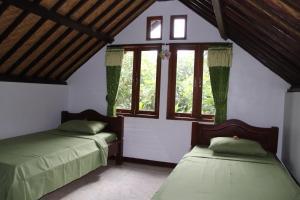 Un ou plusieurs lits dans un hébergement de l'établissement Blue Star Bungalows & Cafe