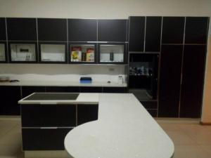 A kitchen or kitchenette at Fahms B&B Gaborone North