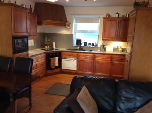 A kitchen or kitchenette at Comber Courtyard Apartment