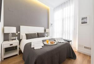 Cama o camas de una habitación en Malasaña Plaza by Madflats Collection