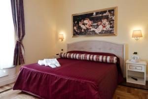 Letto o letti in una camera di Relais Frattina