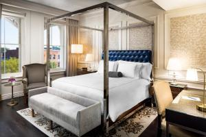 A bed or beds in a room at The Adelphi Hotel