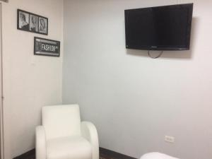 A television and/or entertainment center at Aital
