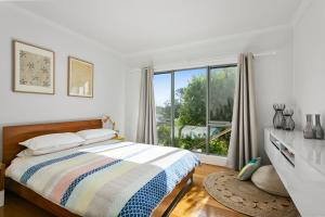 A bed or beds in a room at L'Ciabot- Sea View Tranquility