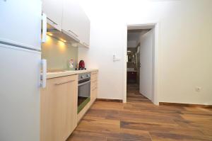 A kitchen or kitchenette at Stella Apartments