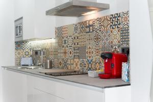 A kitchen or kitchenette at Algo Diferente Apartamentos