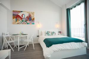 A bed or beds in a room at Algo Diferente Apartamentos
