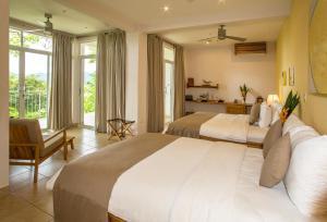 Cama o camas de una habitación en Hotel Boutique Lagarta Lodge