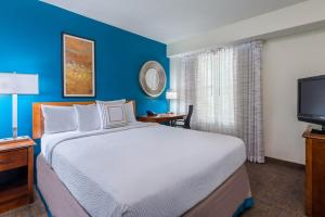 A bed or beds in a room at Residence Inn Tampa Westshore Airport