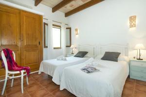 Cama o camas de una habitación en Rustic Villa Aina Near the Old Town