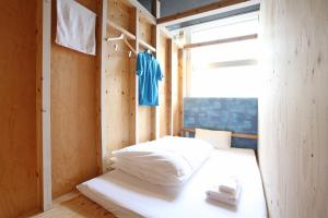A bed or beds in a room at Guest House Chura Cucule Ishigakijima